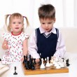 Brother and sister playing chess — Stock Photo #4251658