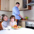 Family has breakfast in the kitchen — Stock Photo #4252110