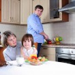 Stock Photo: Family has breakfast in the kitchen