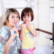 Royalty-Free Stock Photo: Mother and daughter brushing their teeth
