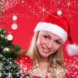 Young girl dressed as Santa Claus - Stock Photo