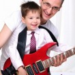 Young father teaches his young son — Stock Photo #4259544