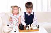 Brother and sister playing chess — Foto Stock