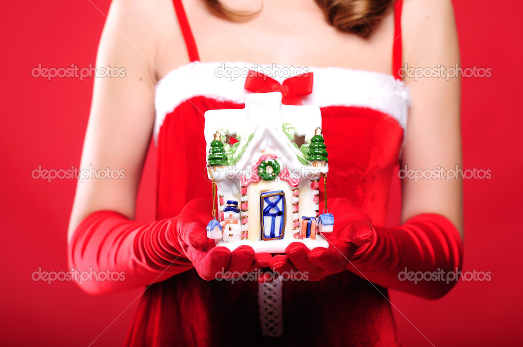Portrait of a young girl dressed as Santa Claus on a red background. Girl gives gifts. Happy New Year and Merry Christmas! — Stock Photo #4259745