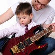 Young father teaches his young son — Stock Photo #4260119