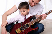 Young father teaches his young son — Stock Photo