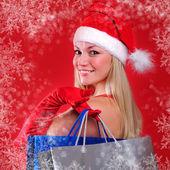 Ung flicka klädd som jultomte — Stockfoto