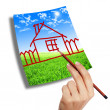 Hand drawing a house on the sky — Stock Photo