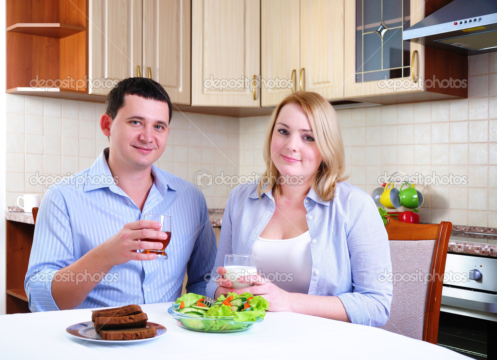 The wife and husband have breakfast together in his kitchen.  Stock Photo #4277712