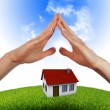 House in the hands against the blue sky — Stock Photo #4399638