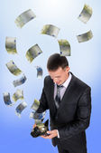 Young man with a wallet — Stock Photo