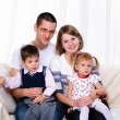 Happy family spending time together — Stockfoto