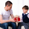 Dad gives his son a gift — Stock Photo #4401308