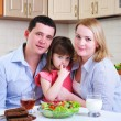 Dad, Mom and their little daughter — Stock Photo #4402149