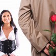Royalty-Free Stock Photo: Young man gives his girlfriend a rose