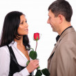 Stock Photo: Young man gives his girlfriend a rose