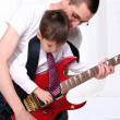 Young father teaches his young son — Stock Photo #4407112