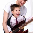 Young father teaches his young son - Foto Stock