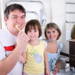 Mom, daughter and father brush their teeth — Stock Photo #4407741