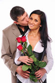Young man gives his girlfriend a rose — Stockfoto