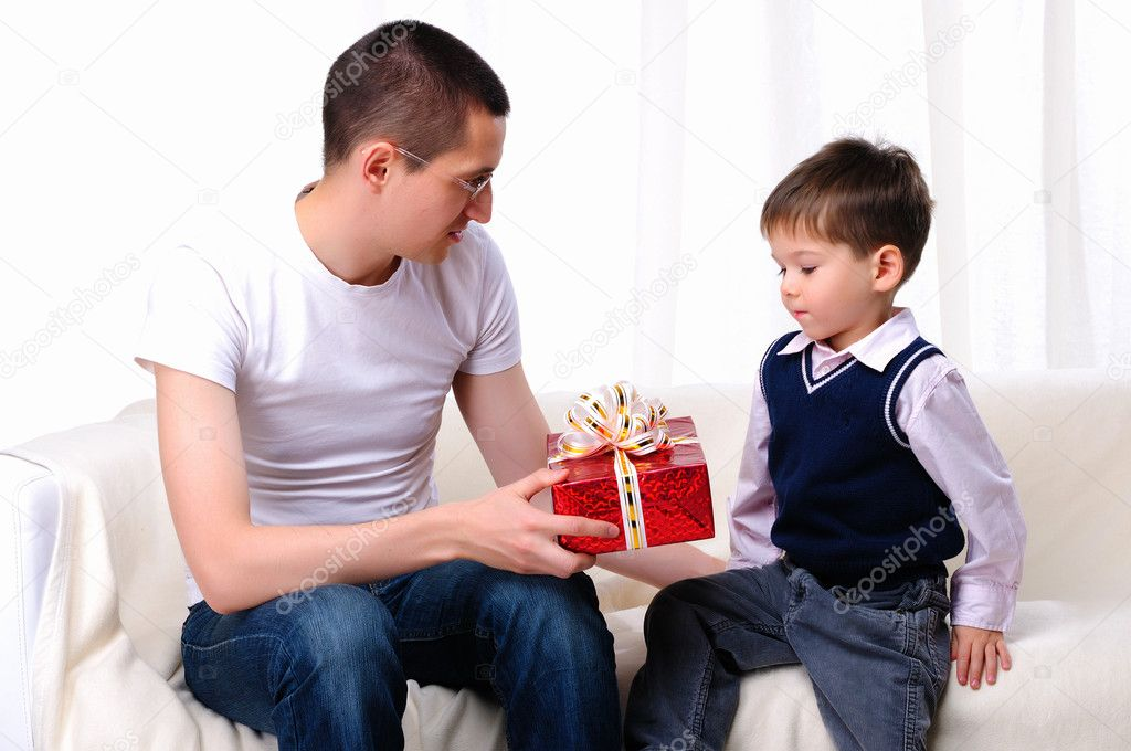 Dad gives his son a gift in red box — Stock Photo #4401308