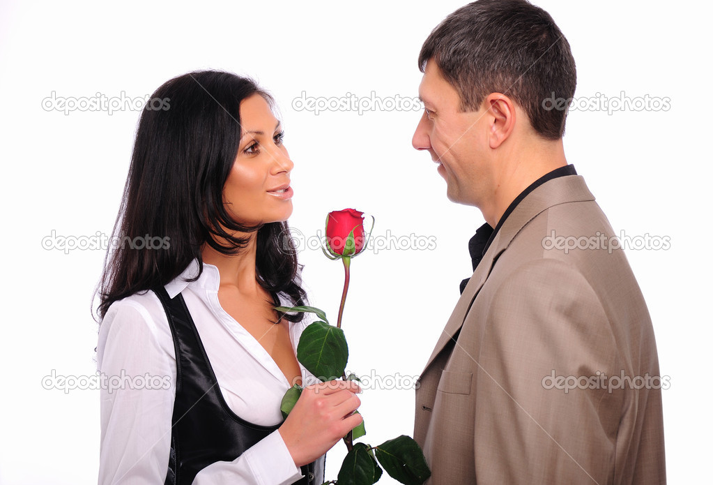The young man gives his girlfriend a rose in honor of Valentine's Day — Stock Photo #4406661