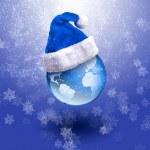 Earth in the Santa hat. — Stock Photo