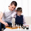 Dad and son playing chess — Stock Photo #4452523