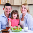 Dad, Mom and their little daughter — Stock Photo #4452942
