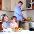 Family has breakfast in the kitchen — Stock Photo #4453230
