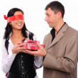 Young man gives his girlfriend a gift — Stock Photo #4455281