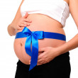 Abdomen a young pregnant woman — Stock Photo
