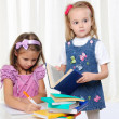 Stock Photo: Little girls are studying literature