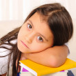 Stock Photo: Little girl has been studying