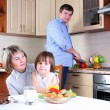 Family has breakfast in the kitchen - Stock Photo