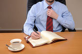 Young business man working in an office — Stock Photo