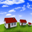 Stock Photo: House in the hands against the blue sky