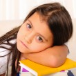 Little girl has been studying - Stock Photo
