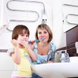 Stock Photo: Mother and daughter brushing their teeth