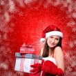 Stock Photo: Portrait of a young girl dressed as Santa Claus