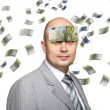 Bald young businessman with banknotes - Stock Photo