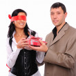 Stock Photo: Young man gives his girlfriend a gift