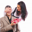 Young girl gives her man a gift - Photo