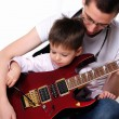 Young father teaches his young son - Stock Photo