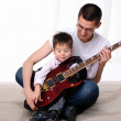 Young father teaches his young son — Stock Photo #4475921