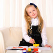 Stock Photo: Little girl draws paint