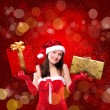 Royalty-Free Stock Photo: Portrait of a young girl dressed as Santa Claus
