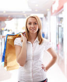 Young beautiful girl in the mall — Stock Photo