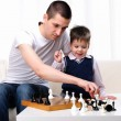 Dad and son playing chess — Stock Photo #4488393