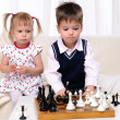 Brother and sister playing chess — Stock Photo #4488398